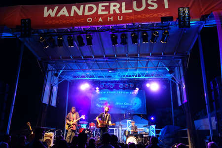 north shore: NORTH SHORE, HAWAII - FEBRUARY 28: Roothub performs on stage during a evening concert at Wanderlust Yoga festival taken February 28, 2015 in North Shore, Hawaii.