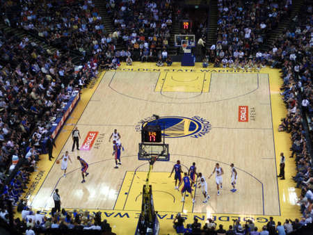 oakland: OAKLAND - NOVEMBER 15: Golden State Warriors Player Stephen Curry dribbles ball down court against the Pistons with 17 seconds on the shoot clock at the Oracle Arena in Oakland, California on November 15 2010.