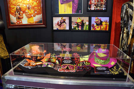 legend: SAN JOSE - MARCH 28: WWE Legend Macho Man outfit, hats, sunglasses and photo displays at WWE Axxess event at the McEnery Convention Center in San Jose, California on March 28, 2015.