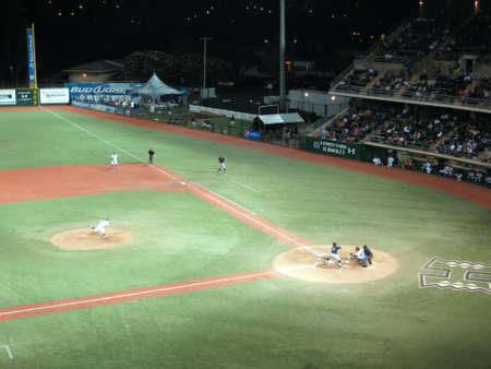 cal: HONOLULU, HI - MAY 16: UH Pitcher Throws pitch to Cal State Fullerton  batter with ball in air during a night game at UH Baseball Les Murakami Stadium in Manoa, Honolulu, Hawaii May 16, 2015. Editorial