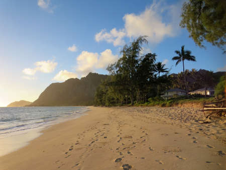 windward: Gentle wave lap on Waimanalo Beach in the early morning light on a nice day Oahu, Hawaii. Stock Photo
