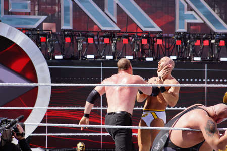 levis: SANTA CLARA - MARCH 29: WWE Wrestler Kane puts hand around neck of Cesaro to setup for a chokeslam during andre the giant battle royal 2015 at Wrestlemania 31 at the Levis Stadium in Santa Clara, California on March 29, 2015.