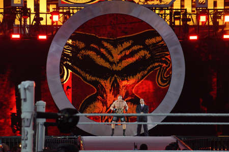 levis: SANTA CLARA - MARCH 29: WWE Champion Brock Lesner and agent Paul Heyman enters arena at, showcase of the immortals, Wrestlemania 31, as night falls with fans cheering at the Levis Stadium in Santa Clara, California on March 29, 2015. Editorial