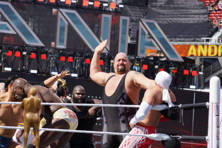 show ring: SANTA CLARA - MARCH 29: WWE Wrestler Big Show sets to slap chest of Los Matadores as other wrestlers fight in ring during andre the giant battle royal 2015 at Wrestlemania 31 at the Levis Stadium in Santa Clara, California on March 29, 2015. Editorial