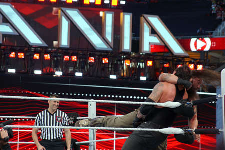 undertaker: SANTA CLARA - MARCH 29: WWE Wrestler Bray Wyatt clotheslines the Undertaker in the corner of the ring during match at Wrestlemania 31 at the Levis Stadium in Santa Clara, California on March 29, 2015.