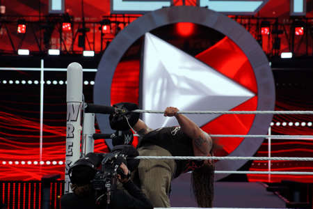 backwards: SANTA CLARA - MARCH 29: WWE Wrestler Bray Wyatt bends backwards while holding ropes in ring during match at Wrestlemania 31 at the Levis Stadium in Santa Clara, California on March 29, 2015.