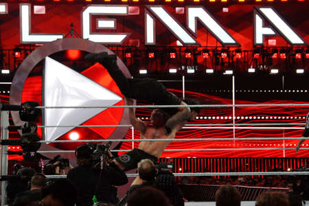 reigns: SANTA CLARA - MARCH 29: WWE Champion Brock Lesner F-5ing Roman Reigns off the top of his shoulders at Wrestlemania 31 at the Levis Stadium in Santa Clara, California on March 29, 2015. Editorial