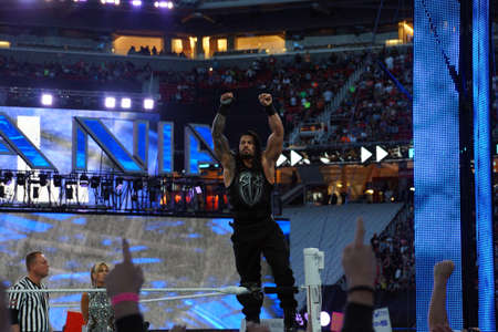 SANTA CLARA - MARCH 29: Roman Reigns wrestler stands on top turnbuckle with arms in the air before start of championship match at Wrestlemania 31 at the Levis Stadium in Santa Clara, California on March 29, 2015. Editorial