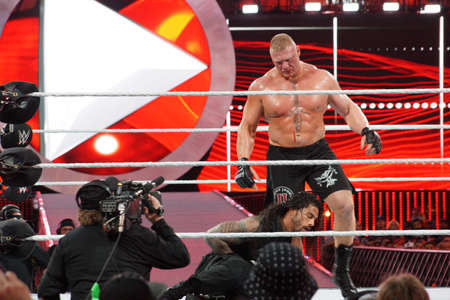 reigns: SANTA CLARA - MARCH 29: WWE Champion Brock Lesner bleeds from face as Roman Reigns holds stomach during main event match at Wrestlemania 31 at the Levis Stadium in Santa Clara, California on March 29, 2015.