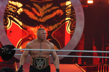 levis: SANTA CLARA - MARCH 29: WWE Champion Brock Lesner with Championship belt on waist in ring at, showcase of the immortals, Wrestlemania 31, as night falls with fans cheering at the Levis Stadium in Santa Clara, California on March 29, 2015.