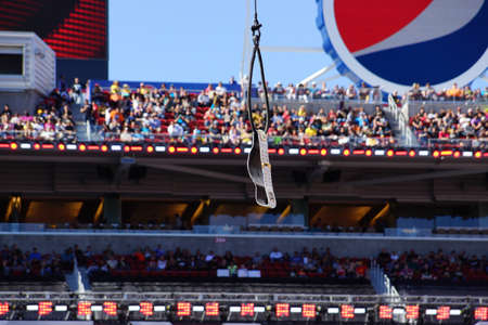 levis: SANTA CLARA - MARCH 29: Intercontinental championship belt hangs in the air before ladder match at Wrestlemania 31 with crowd in the distance at the Levis Stadium in Santa Clara, California on March 29, 2015.