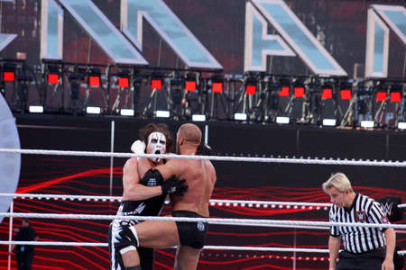lockup: SANTA CLARA - MARCH 29: Triple H knees Sting as they lock-up in ring during match at Wrestlemania 31 at the Levis Stadium in Santa Clara, California on March 29, 2015. Editorial
