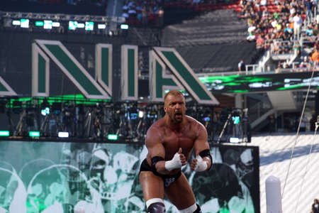 levis: SANTA CLARA - MARCH 29: Triple H points at himself as he stands on top of turnbuckles looking out into crowd before match at Wrestlemania 31 at the Levis Stadium in Santa Clara, California on March 29, 2015. Editorial