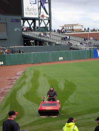 giants: SAN FRANCISCO - APRIL 11: Braves Vs. Giants: Giants grounds drive water hog across grass to remove water out during rain delay taken April 11 2010 at Att Park San Francisco California.