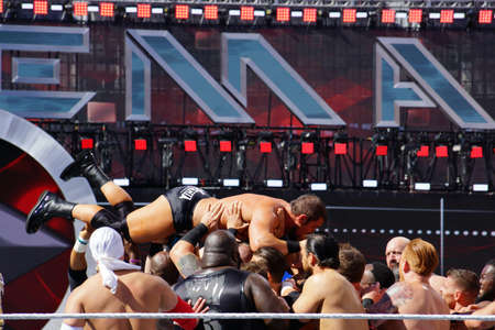 SANTA CLARA - MARCH 29: WWE Wrestlers float Curtis Axel, axelmania, out of the ring during andre the giant battle royal 2015 at Wrestlemania 31 at the Levis Stadium in Santa Clara, California on March 29, 2015.