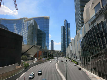 financed: LAS VEGAS - JUNE 29: Harmon street leading to Crystals at City Center on Las Vegas Boulevard on June 29, 2015 in Las Vegas.  With a total cost of 9.2 Billion, CityCenter is the largest privately financed development in the United States.