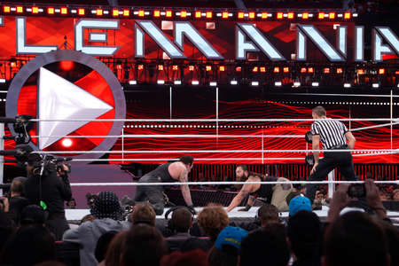 undertaker: SANTA CLARA - MARCH 29: WWE Wrestler the Undertaker stares across at Bray Wyatt on the floor of the ring during match at Wrestlemania 31 at the Levis Stadium in Santa Clara, California on March 29, 2015.