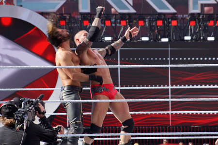 SANTA CLARA - MARCH 29: WWE Wrestler Seth Rollins gets uppercut off the ropes from Randy Orton in the ring at Wrestlemania 31 at the Levi's Stadium in Santa Clara, California on March 29, 2015.
