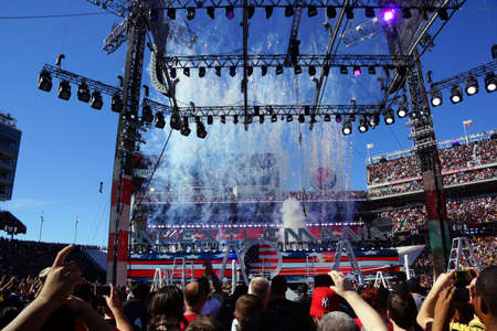 levis: SANTA CLARA - MARCH 29: Fireworks burst as fans cheer before Intercontinental championship belt ladder match at Wrestlemania 31 with crowd in the distance at the Levis Stadium in Santa Clara, California on March 29, 2015. Editorial