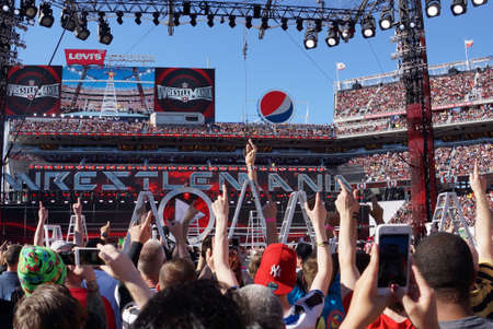 intercontinental: SANTA CLARA - MARCH 29: Daniel Bryan celebrates with yes chant with fans on top of ladder holding Intercontinental championship belt aafter winning ladder match at Wrestlemania 31 at the Levis Stadium in Santa Clara, California on March 29, 2015.