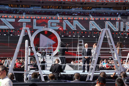 SANTA CLARA - MARCH 29: Pat Patterson stands and talks to refs in ring Intercontinental championship ladder match at Wrestlemania 31 at the Levi's Stadium in Santa Clara, California on March 29, 2015.