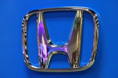 famous industries: HONOLULU - MARCH 14:  HONDA, car manufacturer logo at 2015 First Hawaiian International Auto Show  Oahu, Hawaii March 14, 2015.  HONDA is a Japanese multinational car and motorbike manufacturer founded in 1946.