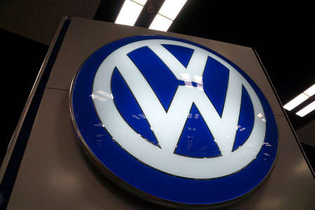 automaker: HONOLULU - MARCH 14:  Close-up of VW car manufacturer logo at 2015 First Hawaiian International Auto Show  Oahu, Hawaii March 14, 2015.  Volkswagen is a German automobile manufacturer and the biggest German automaker and the third largest automaker in the Editorial