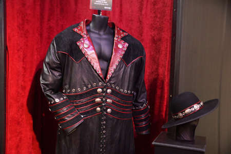 undertaker: SAN JOSE - MARCH 28: WWE Legend the Undertaker Jacket and hat entrance outfit on display from Wrestlemania XXX at WWE Axxess event at the McEnery Convention Center in San Jose, California on March 28, 2015. Editorial