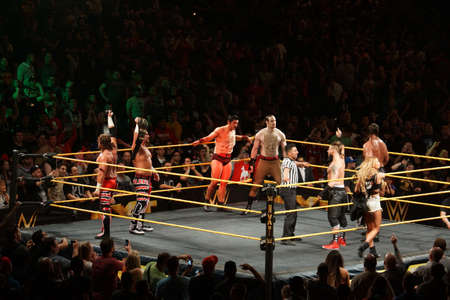 san jose: SAN JOSE - MARCH 27: NXT Tag Team Champions Blake and Murphy hold titles in the air with the vaudevillians and Enzo Amore, Big Cass in the ring at the San Jose Event Center in San Jose, California on March 27, 2015.