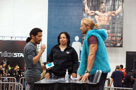 punch press: SAN JOSE - MARCH 28: NXT Wrestle Tyler Breeze talks to fan holding smartphone in hand at WWE Axxess event at the McEnery Convention Center in San Jose, California on March 28, 2015.