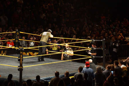 wrestle: SAN JOSE - MARCH 27: NXT Wrestle Sami Zayn leans over ring ropes as he talks to champion Kevin Owens standing on the outside at the San Jose Event Center in San Jose, California on March 27, 2015.