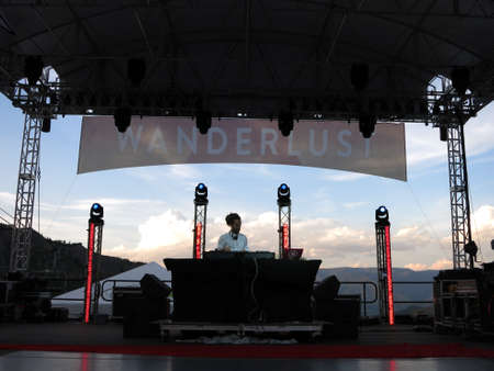 wanderlust: SNOWMASS, CO - JULY 3:  DJ Drez spins on stage during concert with mountain landscape in backgroundduring Wanderlust festival at Snowmass Village area in Colorado on July 3, 2015.