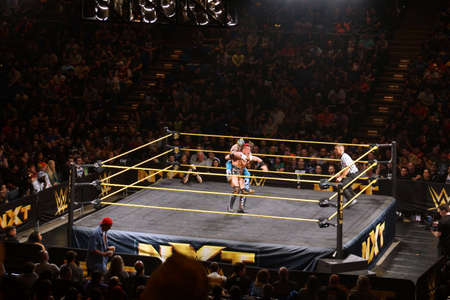 punch press: SAN JOSE - MARCH 27: WWE NXT Superstar Kalisto puts sleeper hold on wrestler Solomon Crowe during match at the San Jose Event Center in San Jose, California on March 27, 2015.