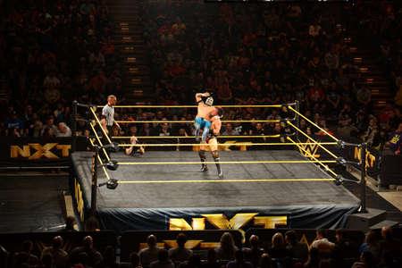 superstar: SAN JOSE - MARCH 27: WWE NXT Superstar Kalisto gets back dropped by wrestler Solomon Crowe during match at the San Jose Event Center in San Jose, California on March 27, 2015. Editorial