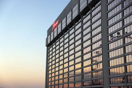 siegel: LAS VEGAS - JUNE 27: The famous Flamingo Hotel with iconic neon signs on top of hotel at dawn on June 27, 2015 in Las Vegas, Nevada. It was the third resort to open on the Strip & the oldest resort on the Strip still in operation. Editorial
