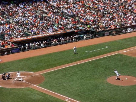 ca he: SAN FRANCISCO - JULY 3: Padres pitcher Clayton Richard steps forward as he throws pitch to Giants batter Aubrey Huff with ball in air during day game at ATT Park in San Franciso, CA on July 3, 2011. Editorial