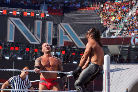 levis: SANTA CLARA - MARCH 29: WWE Wrestler Seth Rollins gets crouched in top turnbuckle as Randy Orton stands looking into crowd during match at Wrestlemania 31 at the Levis Stadium in Santa Clara, California on March 29, 2015.