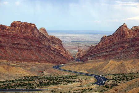 san rafael: Trucks drive along road that winds through Spotted Wolf Canyon in Utah, USA.