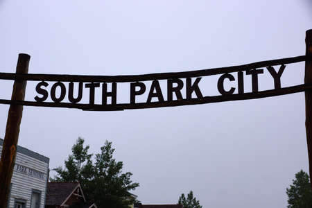 south park: Historic South Park City Sign hangs in the air in Colorado.