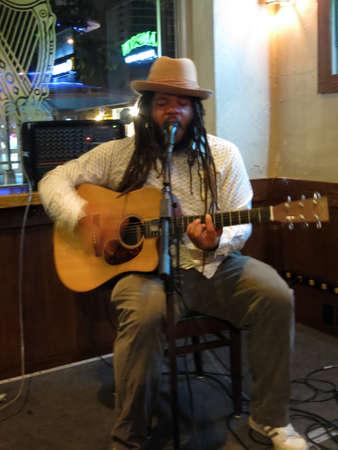 keith: WAIKIKI, HI - FEBRUARY 21, 2015: Reggae Musician Keith Batlin sings and plays guitar as he jams at the Kelley ONeils in Waikiki, Hawaii.