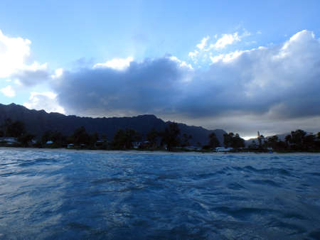 windward: Waimanalo Bay with Beach and Koolau Mountains with clouds in the sky at dusk on Oahu, Hawaii. Stock Photo