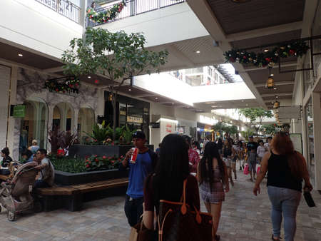 ted: HONOLULU, HI - NOVEMBER 26: Crowd of People around mall near Kate Spade and Ted Baker on Black Friday at the Ala Moana shopping center. taken on November 26, 2015 at Ala Moana Shopping center in Honolulu, Hawaii.