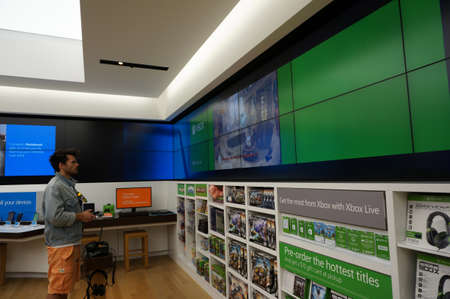 xbox: SAN FRANCISCO - OCTOBER 11:  Man stands holding controller plays  Xbox One inside Microsoft Windows Store during big sale in San Francisco whos technology is in most modern computers  in San Francisco on October 11, 2015.