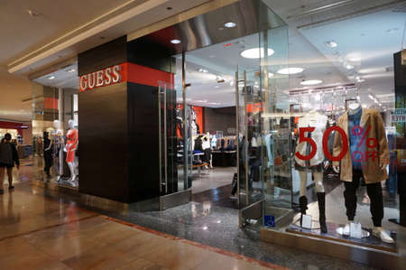 shopfront: SAN FRANCISCO - OCTOBER 11:  Guess Shop in mall with 50 percent off sign. the store is an American upscale clothing line brand and during the 1980s was one of the most popular brands of jeans. in San Francisco on October 11, 2015. Editorial