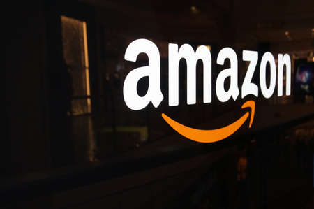 amazon com: SAN FRANCISCO - OCTOBER 11:  Amazon logo on black shiny wall in San Francisco mall in California on October 11, 2015.  Amazon is an American international electronic commerce company. It is the worlds largest online retailer. Editorial