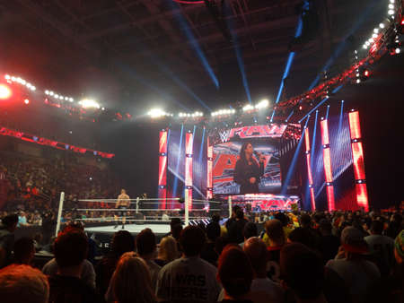 brock: SAN JOSE - MARCH 30: The Beast Brock Lesner stands in the ring ready for action with Stephanie McMahon on screen holding mic during live taping of WWE Monday Night Raw at the SAP Center in San Jose, California on March 30, 2015.