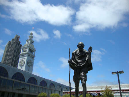 mahatma: SAN FRANCISCO - JULY 6: Statue of Peace activitist Ghandi By The Ferry Building in San Francisco, California. July 6. 2010.