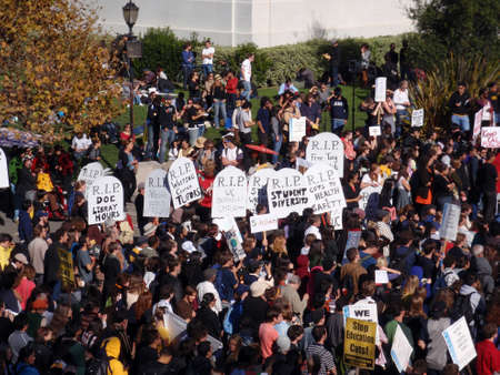 occupy wall street: BERKELEY, CA - NOVEMBER 18: crowd of protesters hold signs and rally tuition increases in front of Sproul Hall on UC Berkeley November 18 2009 at Berkeley, California.