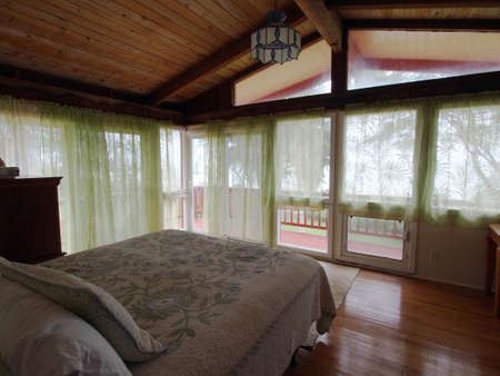 sea fans: Inside second floor master Bedroom with king bed with ocean view in Waimanalo, Oahu.