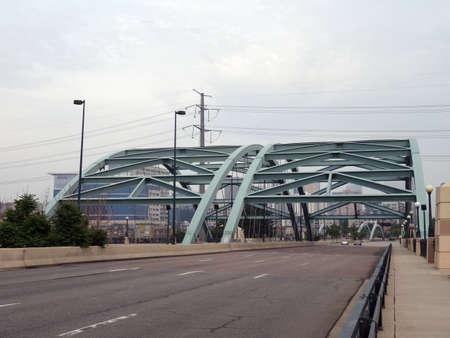 denver parks: Double Speer Boulevard Bridge over river leading into Denver, Colorado.